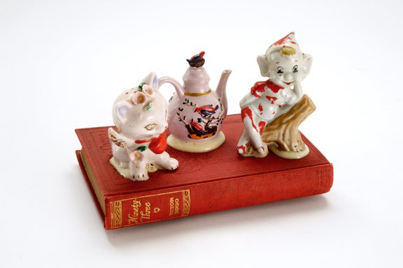 """Tea for Two""  Ceramic and Gorilla Glue on discarded book.  5"" h X 7"" w X 4"" d 2009"