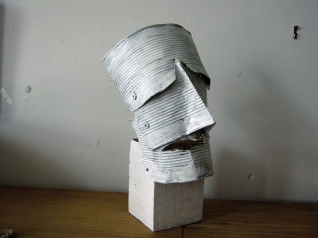 "Lawrence Swan, Head On Block, 2012. Tin cans, wood block, acrylic paint, 13"" X 7"" X 6"""